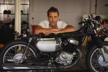 Bike Mechanic Sitting With Bik...