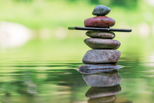 Balance Of Stones And Smartphone In Water