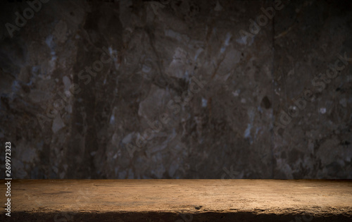 Old wooden table with brick background dark - 269972323