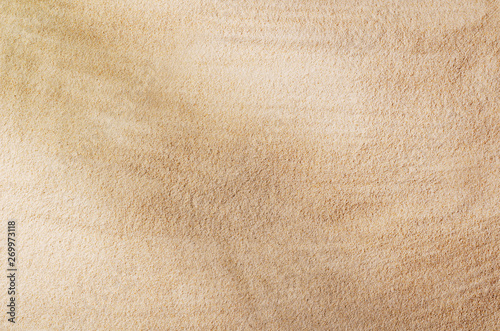 Fototapeta Sandy beach background top view with visible sand texture. Backdrop for mockups and advertising. obraz