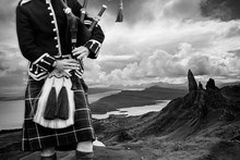 Traditional Scottish Bagpiper In Full Dress