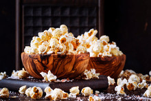 Salted Popcorn In A Wooden Bowl, Unhealthy Food, Dark Wooden Kitchen Table Background, Selective Focus