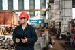 Leinwandbild Motiv Supervisor at work in heavy industry factory.