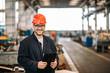 Leinwandbild Motiv Portrait of a smiling handsome factory worker.