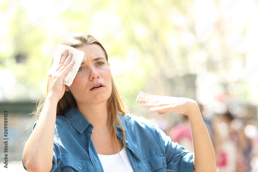 Fototapety, obrazy: Unhappy woman sweating suffering a heat stroke