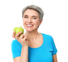 Mature Woman With Apple On White Background