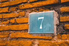 Number 7 Sign On Grey Stone