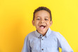 Laughing African-American boy on color background