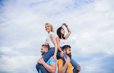 Having a good time together. Loving couples having fun activities outdoor. Loving couples enjoy fun together. Playful couples in love smiling on cloudy sky. Happy men piggybacking their girlfriends
