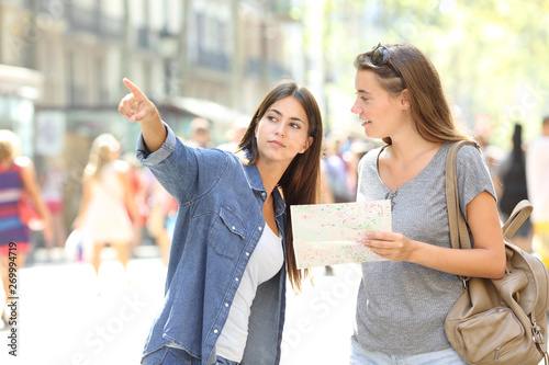 Lost tourist asking for help from a pedestrian