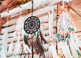 Fototapeta Nowy Jork - accessories and handmade dream catcher souvenirs at the hippie de las Dalias market on the island of Ibiza, in summer.