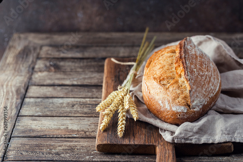 Door stickers Bread Freshly baked homemade traditional bread on rustic wooden table
