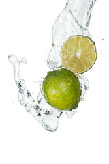 green fresh whole lime and half with clear water stream and drops isolated on white