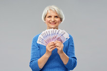 Savings, Finances And People Concept - Smiling Senior Woman Holding Fan Of Five Hundred Euro Money Banknotes