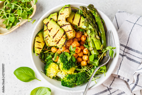 Fotomural  Buddha bowl with grilled avocado, asparagus, chickpeas, pea sprouts and broccoli