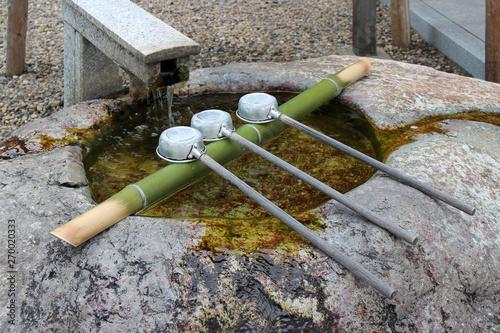 ladles for ablution in a shinto shrine in izumo (japan) Slika na platnu