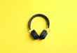 canvas print picture - Stylish headphones on color background, top view