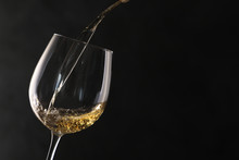 Pouring White Wine Into Glass ...
