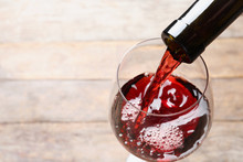 Pouring Red Wine From Bottle I...