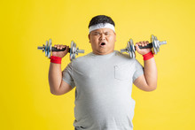 Fat Men Are Exercising By Lift...