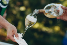Waiter Pouring Champagne Into A Glass