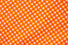 Classic Orange Color Plaid Fabric Or Tablecloth Background