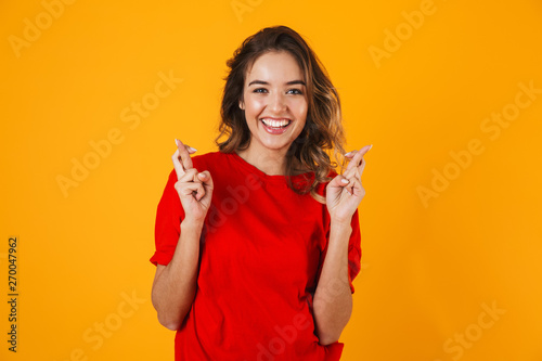 Fotografia Portrait of a lovely cheerful young woman standing