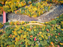 Scenic Highway With Covered Albany Bridge At Autumn In New Hampshire, USA. Fall In New England. Aerial Drone Shot.