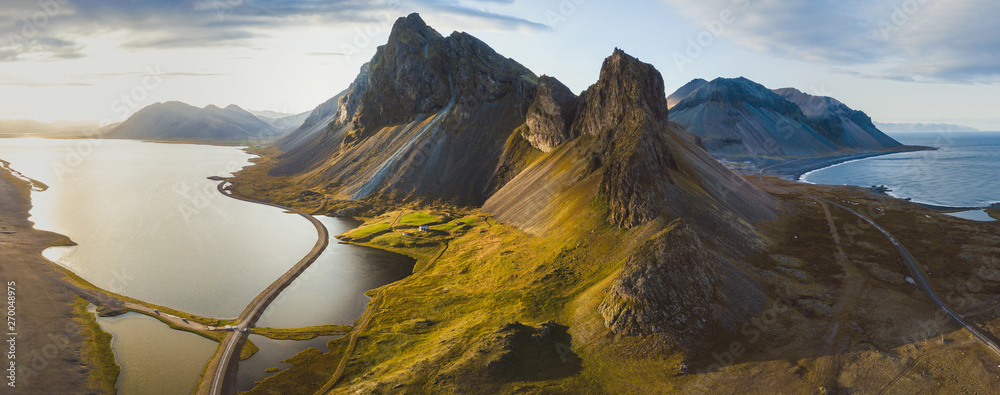 Fototapeta scenic road in Iceland, beautiful nature landscape aerial panorama, mountains and coast at sunset