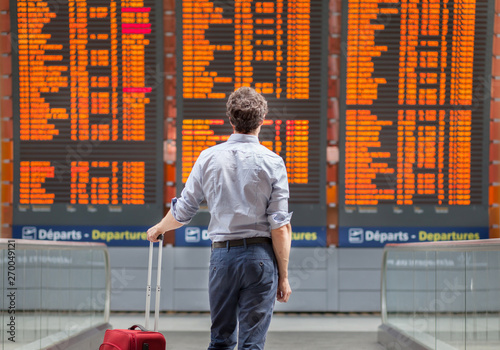 travel with international flight, person passenger waiting in airport departure Fototapeta