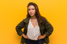 Young European Woman Isolated Over Yellow Background Scolding Someone Very Angry.