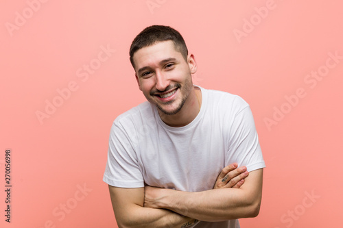 Fotomural  Young casual man laughing and having fun.