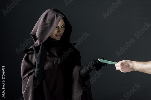partial view of man giving euro banknotes to woman in death costume isolated on Tablou Canvas