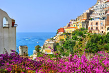 Colorful Flowers And Buildings Looking Out To Sea In The Coastal Town Of Positano, Amalfi Coast, Italy