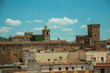 Cityscape with old building roofs and church bell tower at Caceres