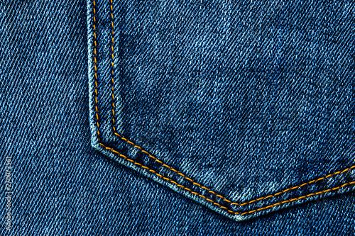Fotomural  Blue denim jeans background pocket with seam and orange thread stitches