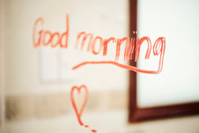Image Of Text Good Morning Written With Red Lipstick On The Mirror In Bathroom