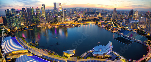 Aerial view of Singapore skyline and Marina Bay at sunset