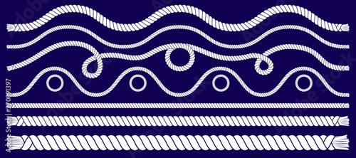 Obraz na płótnie Marine rope knots and frames set with white rope ornament and nautical knots on dark background