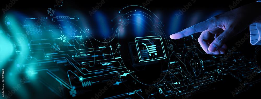 Fototapeta Hand pushing virtual symbol of online shopping with modern UI computer and smart phone.
