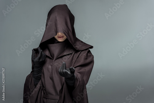 Obraz na płótnie front view of woman in death costume gesturing isolated on grey