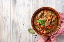 Turkey Meat Stew With Mushrooms And Vegetables In Ceramic Bowl On Wooden Table. Top View. Copy Space.