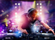 Leinwandbild Motiv DJ playing music at the discotheque