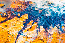 Abstract Art Texture Background. Fantasy Cake With Glazed Top And Sugar Powder. Orange And Blue Paint Splash.