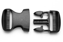 Black Plastic Fastex Clip For Backpacks On A White Background
