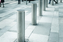 Stainless Steel Bollard Entering Pedestrian Area On Vienna City Street. Car And Vehicle Traffic Access Control