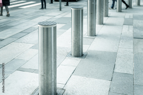 Fotomural Stainless steel bollard entering pedestrian area on Vienna city street