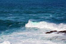 Sea Water Turbulent Around Rocks