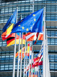canvas print picture - Clean flags of all member states of the European Union waving in calm wind in front of the Parliament headquarter on the day of 2019 European Parliament election.