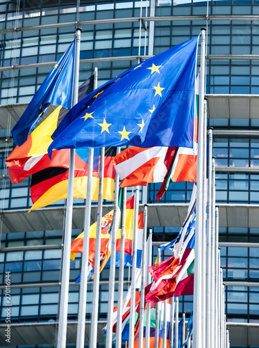 Fotografía  Clean flags of all member states of the European Union waving in calm wind in front of the Parliament headquarter on the day of 2019 European Parliament election